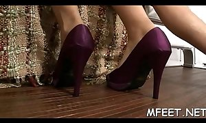 Seductive and naughty brunette organizes a hot footjob for her chap