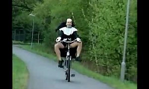 Nun on bike.wmv